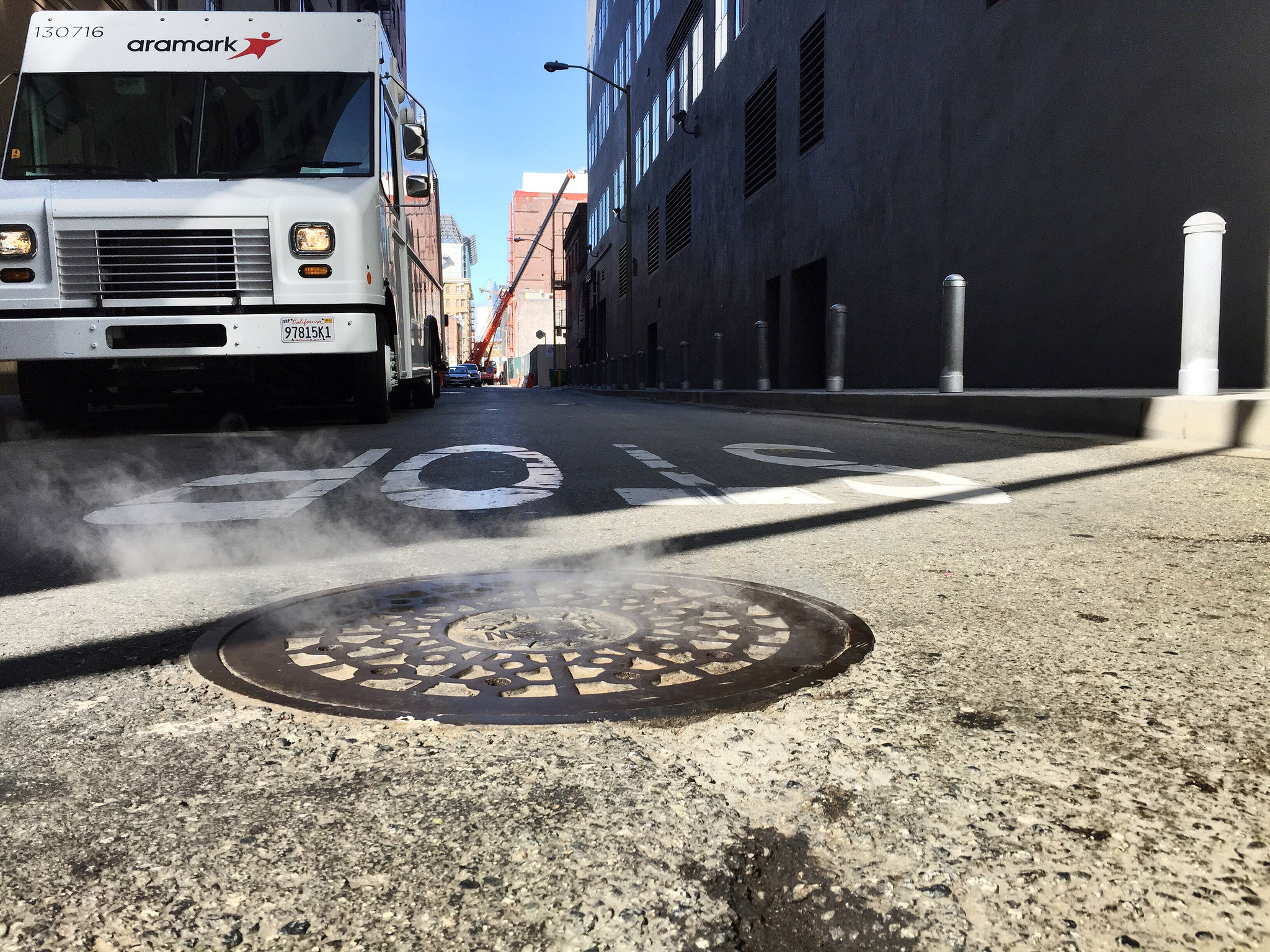 milwaukee city steam manhole cover aramark truck