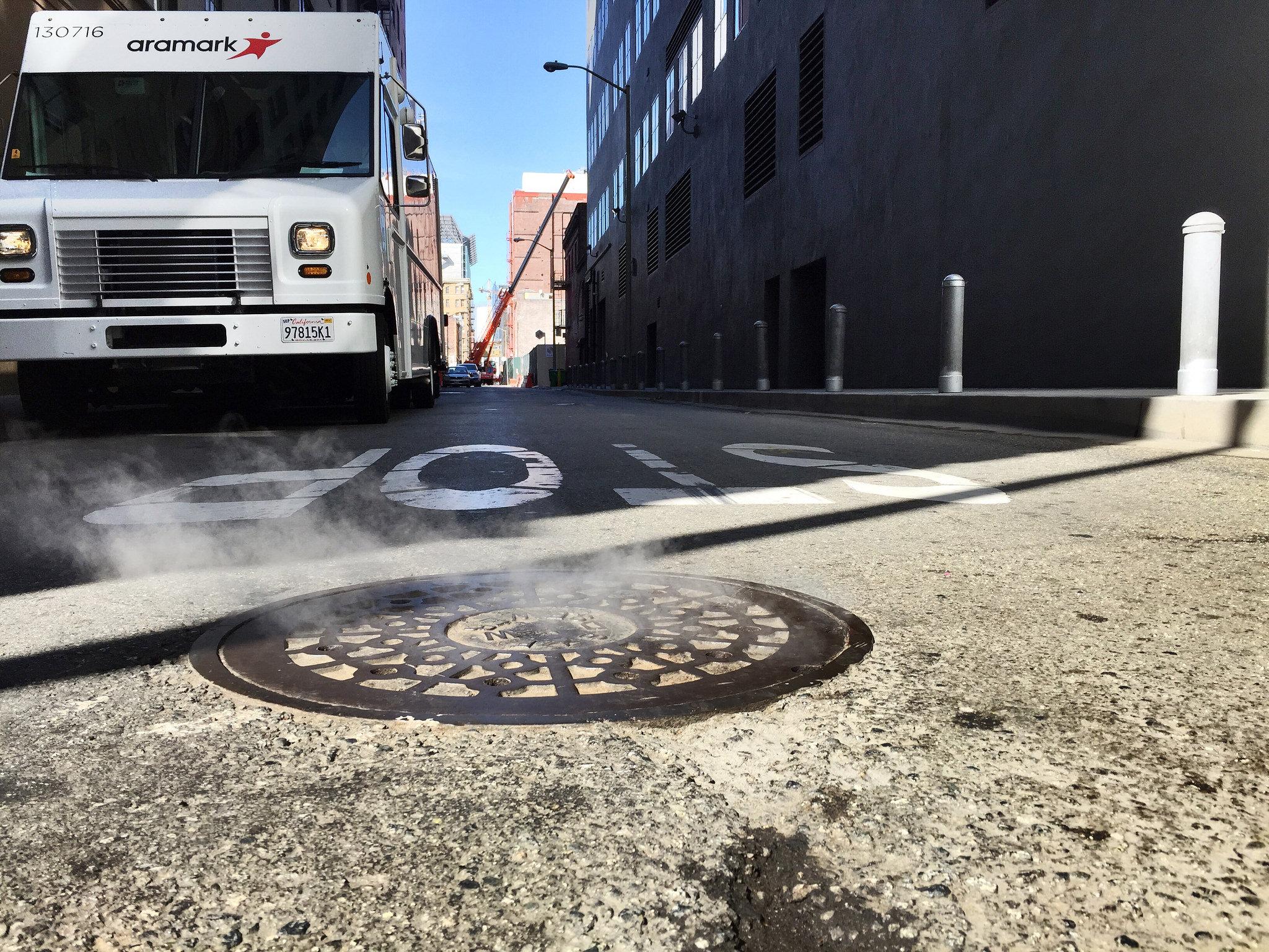 milwaukee city steam manhole cover aramark truck
