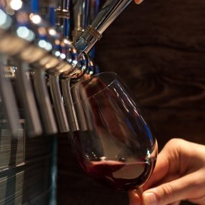 pouring wine from a wine on tap system