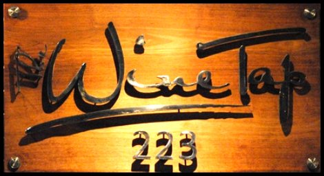 The wine tap 223 wood and metal sign featuring wine on tap