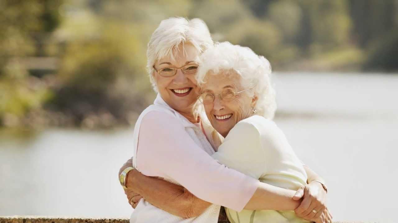 baby boomer daughter hugging elderly mother