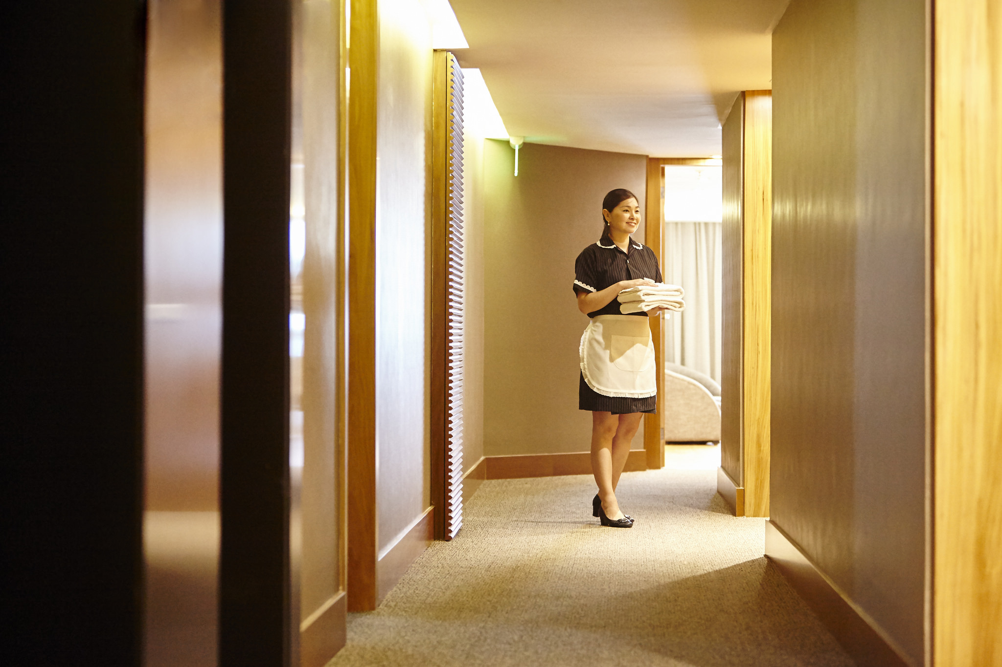 hotel maid in hallway hotel housekeeping costs