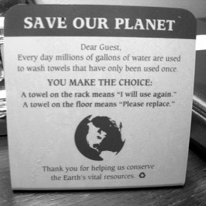 This informational plaque can help bring down your hotel housekeeping costs by asking guests to reuse their linens.
