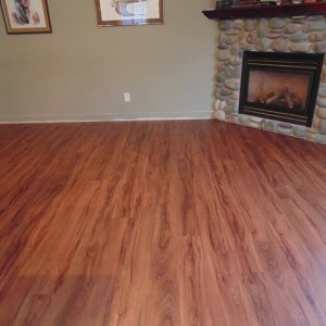 vinyl plank flooring in living room with fireplace
