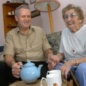 senior living options in home care pouring her tea