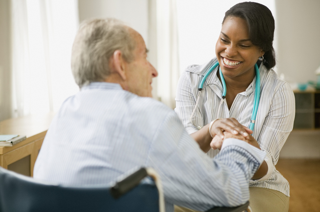senior living options female caregiver with senior man