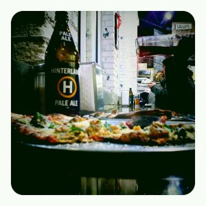 Wisconsin Craft Beer hinterland pale ale bomber and pizza at classic slice restaurant