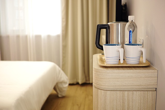 Personal touches like coffee, mugs, and water bottles make hotel rooms feel more welcoming to your guests.