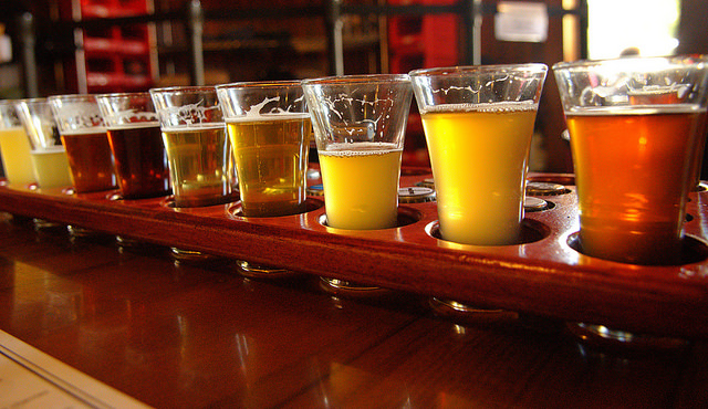 A flight of Belgian sour beer samples.