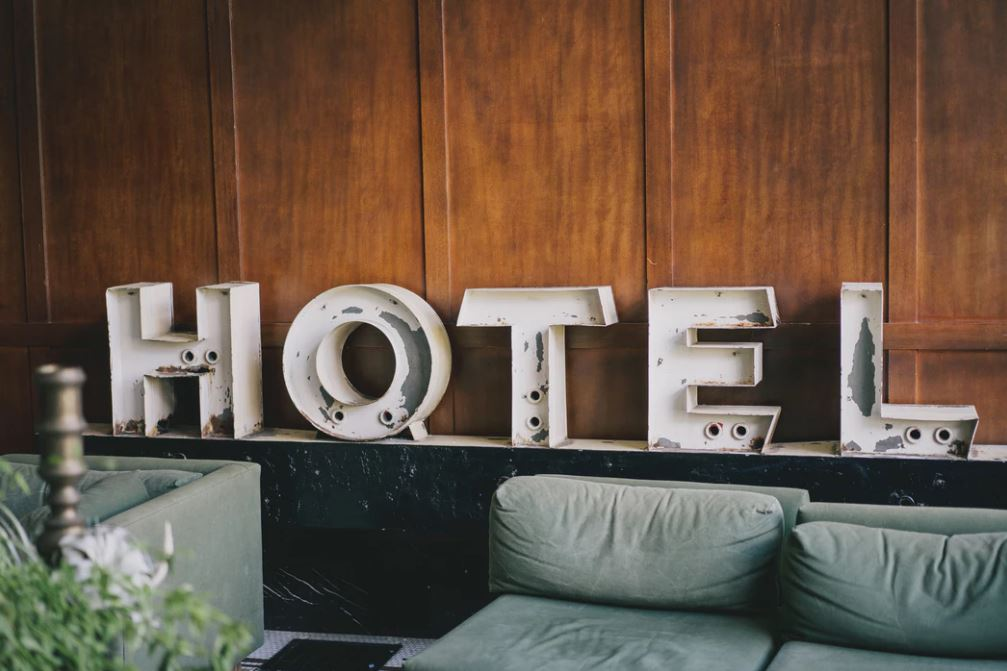 "Vintage letters spelling out ""hotel"" in a hotel lobby."
