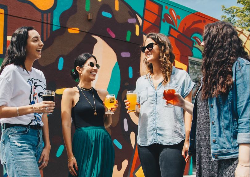 Hosting special brewery events like private parties, weddings, or birthdays opens your doors to new patrons, like these four female friends sharing beer.