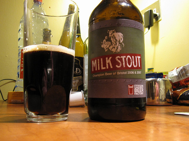 A classic milk stout beer is dark in color with rich and sweet flavor profiles