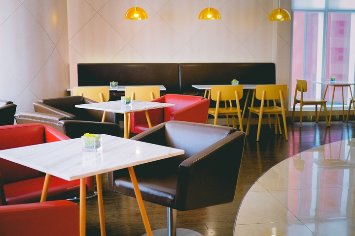 The minimalist restaurant decor trend is popular for it's simple design and clean looks