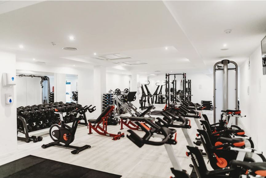 hotel fitness center with weights, stationary bikes, and treadmills