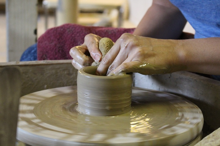 art therapy for seniors is great for activating blood flow through the hand joints while clay making