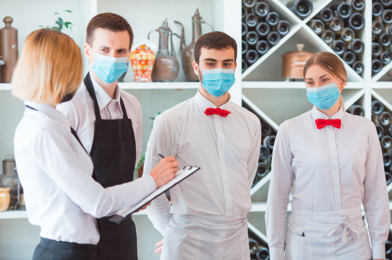 Wearing masks while working in a restaurant is a necessary step to protect staff and customers