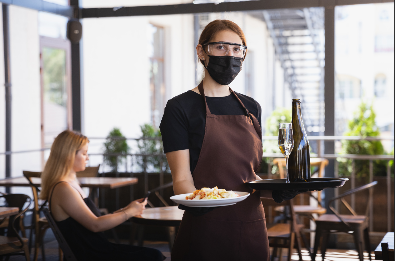 The new normal is seeing wait staff wearing masks and other protective gear while working in restaurants during Coronavirus