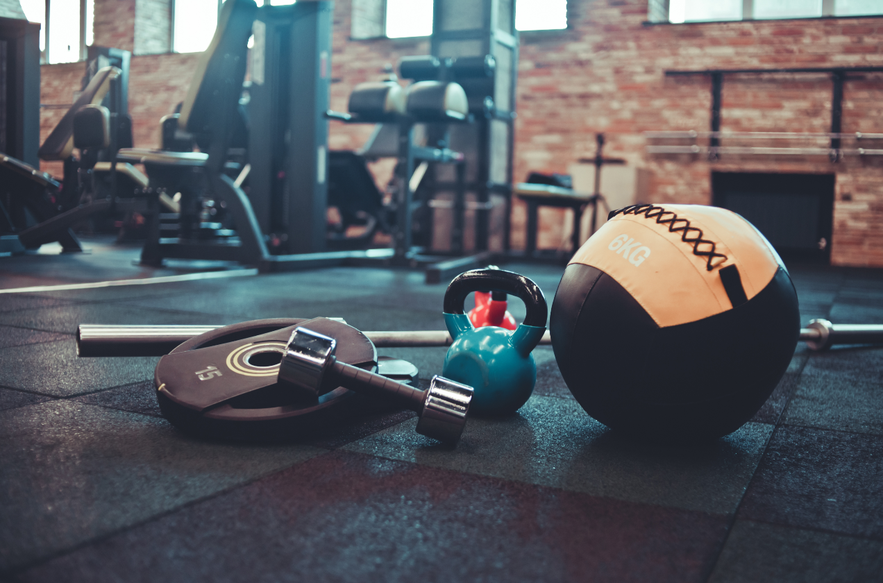 Sanitizing shared gym equipment like weights is a crucial step to keeping your gym healthy and safe.