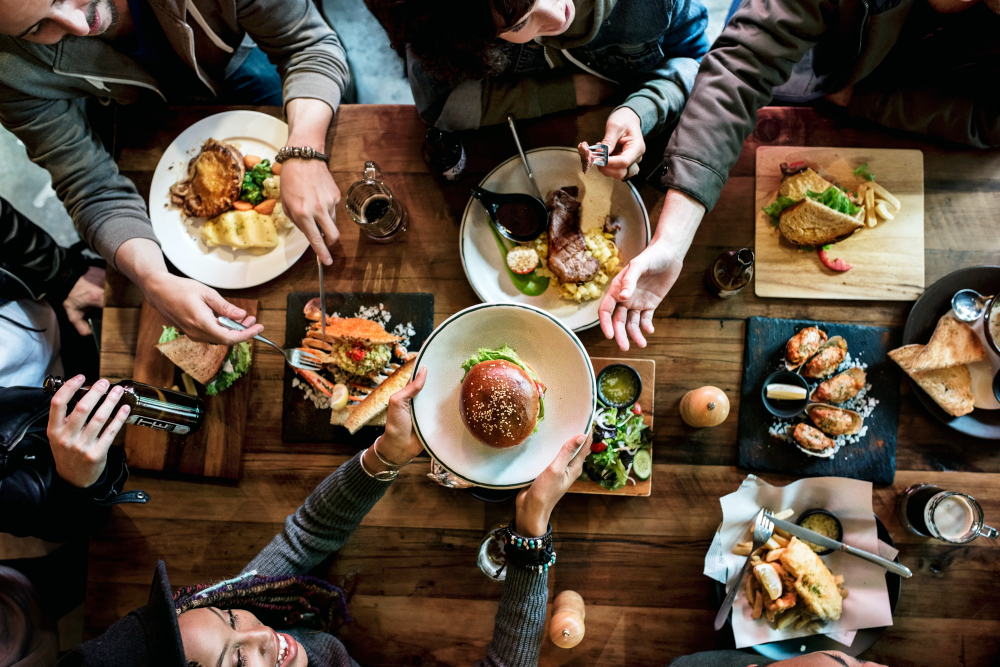 Friends come together for a night out to enjoy delicious food at their favorite restaurant